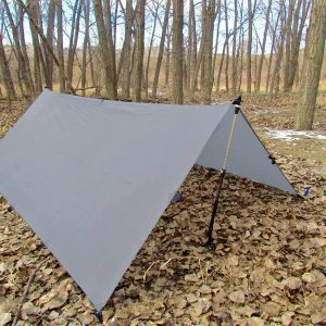 A LiteOutdoors Silnylon Tarp pitched in an A-Frame using hiking poles as support