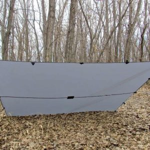 A LiteOutdoors Silnylon Tarp pitched in a lean to like fasion.