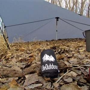 A LiteOutdoors Silnylon Tarp shown packed in a compact carry case.